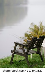 Empty wooden chair down by the lake
