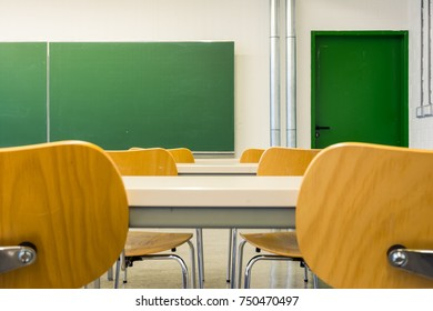 Empty Wooden Chairs at Tables Depth of Field Lecture Hall Nobody Green Chalkboard University Education College Higher