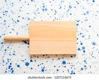 Empty Wooden cutting board on white and blue background