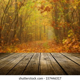 Empty wooden deck table with autumn background. Ready for product display montage.