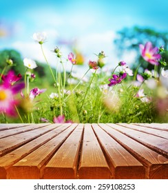 Empty wooden deck table over beautiful spring  garden background
