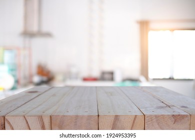 Empty wooden desk platform blur kitchen background for presentation product.