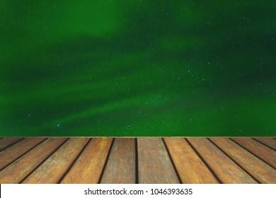 Empty wooden floor and aurora landscape view.