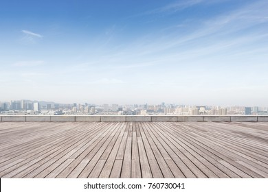 empty wooden floor and cityscape of shaoxing in blue foggy sky