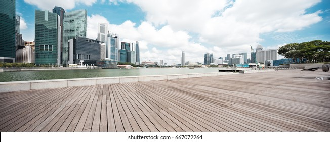 empty wooden floor with modern buildings in singapore