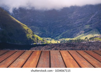 Empty wooden floor and mountain landscape view.