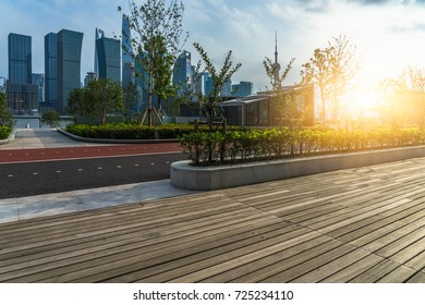 Empty wooden footpath front modern building in shanghai