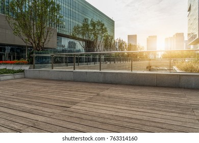 Empty wooden footpath front modern building