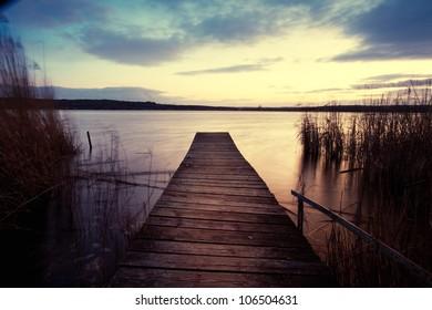 empty wooden jetty in the evening, sundown - Shutterstock ID 106504631