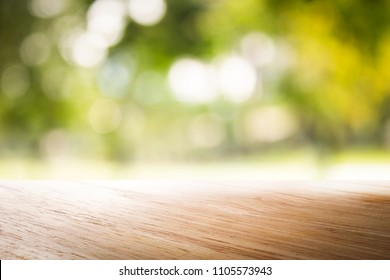 empty wooden on blurred nature backdrop. Wood table top. can used for display or montage your products