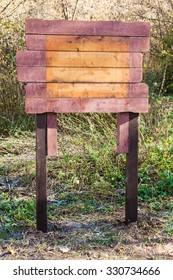 empty wooden outdoor pointer in urban park in autumn day