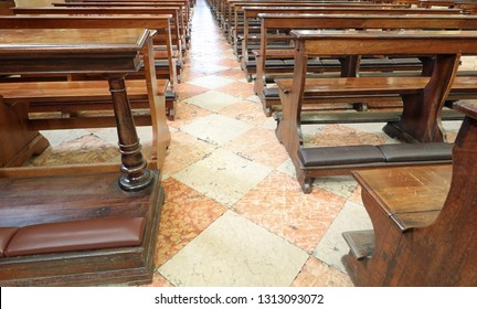 Empty wooden pew inside the old church without people