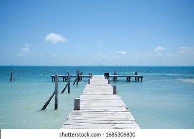 empty wooden pier and full ocean view