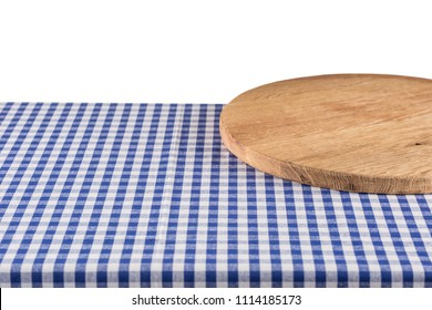 Empty wooden pizza board on blue checkered tablecloth isolated on white.