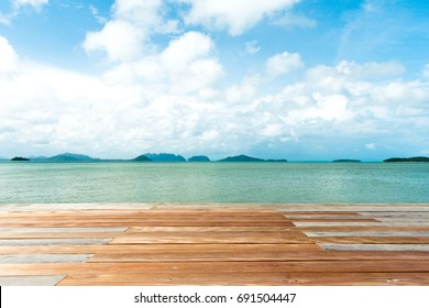 Empty wooden plank over sea background for product display montage