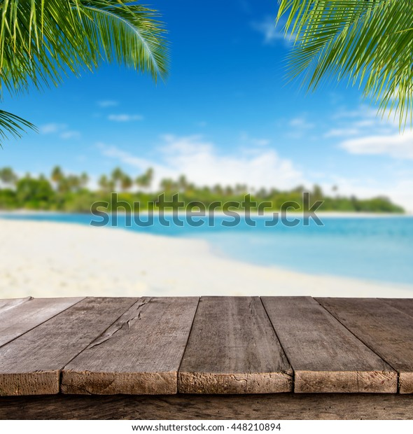 Wood Table Top On Blurred Beach Background Vintage Tone: Empty Wooden Planks Blur Beach On Stock Photo (Edit Now