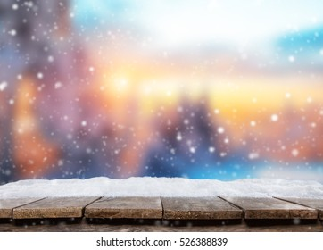 Empty wooden planks with evening winter blur background. Ideal for product placement