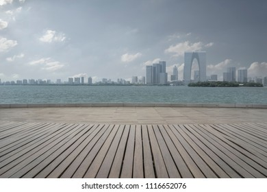 empty Wooden platform and modern architecture in the city