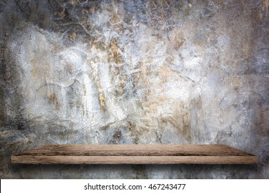 Empty wooden shelf with bare concrete background. For display or montage your products.