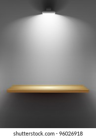 Empty wooden shelf on the wall, illuminated by searchlights.