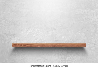 Empty wooden shelf over on bare concrete wall background