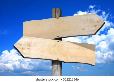 Empty wooden signpost with two arrows.