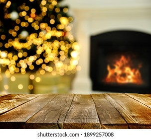 Empty wooden surface and blurred view of fireplace in room