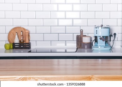 Empty wooden surface on the background of the modern kitchen with white tiles