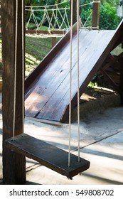 Empty wooden swing in the garden, stock photo