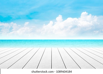 Empty wooden table with beautiful beach blurred background in summer time.
