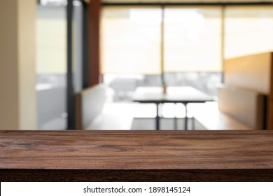 Empty wooden table with blur background of office and meeting room.