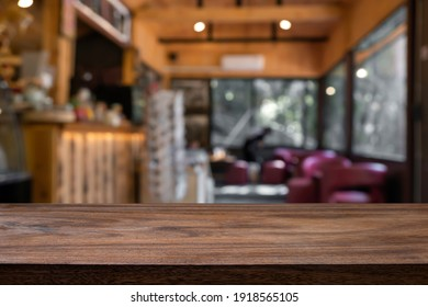 Empty wooden table with blur background of cafe and restaurant. for present product.
