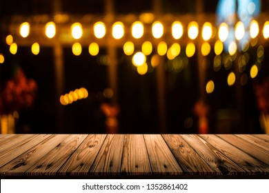 Empty wooden table with blurred bokeh background, For product display, Dark tone.