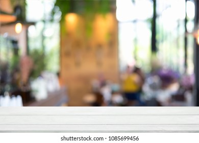 Empty wooden table and blurred cafe background, can be used for display or montage your products