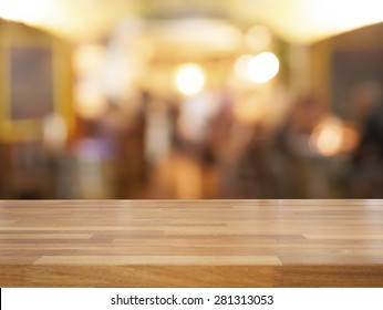 Empty wooden table and blurred cafe background, product display