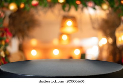 Empty wooden table and blurred Christmas background of abstract in front of coffee shop or restaurant for display of product or for montage.