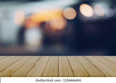 Empty wooden table with blurred city night background,product display montage Concept,Template mock up for display of product.Mock up for display or montage of product,Business presentation