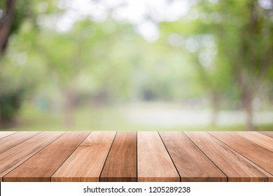 Empty wooden table with blurred green background with a country outdoor theme,Template mock up for display of product