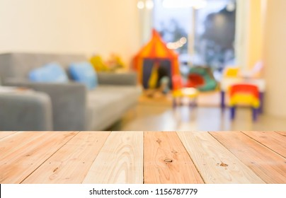 empty wooden table and blurred image of play area in the dental clinic