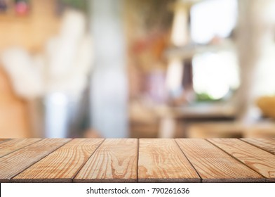 empty wooden table with blurred montage coffee shop cafe / restaurant background