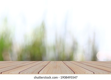 Empty wooden table with blurred nature backgrounds