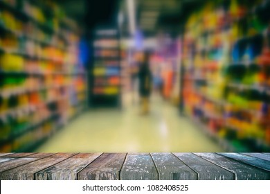 Empty Wooden Table with Blurred Supermarket Background for Business Concept, Suitable for Presentation, Web Temple, Backdrop, and Product Display.