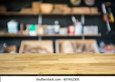 empty wooden table with blurred tools shelf background