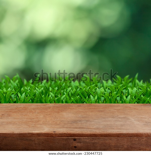 Empty wooden table with bokeh background