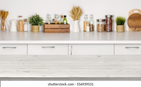 Empty wooden table with bokeh image of kitchen bench interior - Shutterstock ID 556939531
