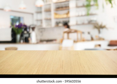 Empty wooden table in front of abstract blurred background of cafe. can be used for display or montage your products.Mock up for display of product