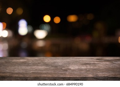 Empty wooden table in front of abstract blurred background of bokeh light . can be used for display or montage your products.Mock up for display of product