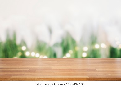Empty wooden table and green plants and circle light bokeh background