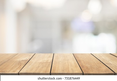 Empty wooden table and interior background, product display, blurred light interior background with bokeh, Ready for product montage