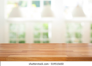 Empty wooden table and modern  background with green ourdoor view against window and lamp, Ready for product montage